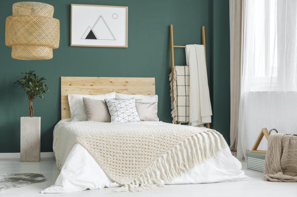 Green cozy bedroom interior